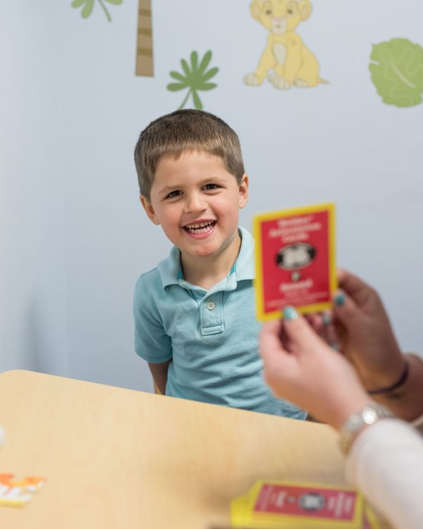 A child working with flashcards representing speech therapy offered by feeding therapy provider South Shore Therapies in Southern MA